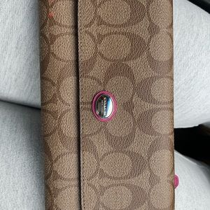 Brown and pink coach wristlet
